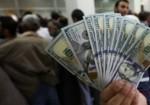 """الحوالات المالية إلى غزة """"خذها شيكل أو يفتح الله"""""""