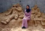 """رانا الرملاوي.. ترسم بـ """"الرمل"""" للحرية والسلام"""