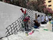 جداريات غزة.. فنانون يرسمون بنكهة المقاومة